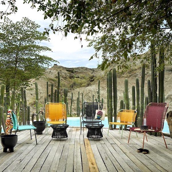 Cielo Lounge Chair von Ames. Sessel bespannt mit Recycling-Kunststoffgeflecht in der Farbe Honey